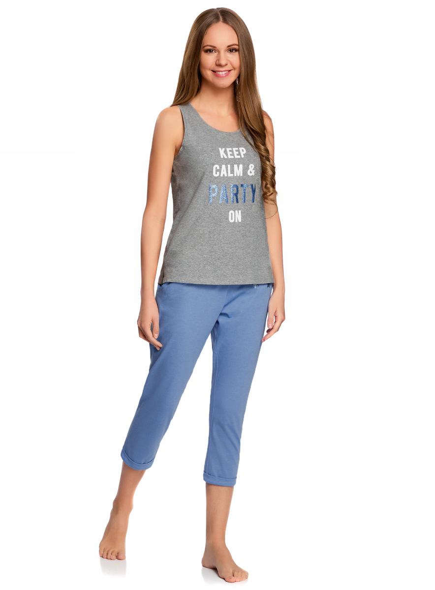 Пижама женская oodji Ultra, цвет: синий, серый. 56002206-2/46897/7523P. Размер XS (42)56002206-2/46897/7523PЖенская пижама от oodji, состоящая из майки и бридж, выполнена из хлопкового материала. Майка спереди оформлена принтованной надписью, бриджи – однотонные.