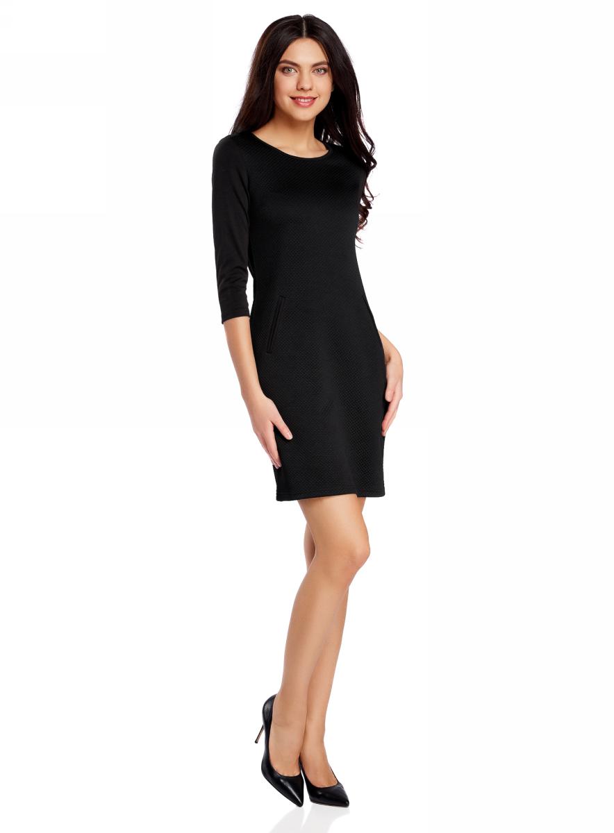 Платье oodji Collection, цвет: черный. 24001100-2/42408/2900N. Размер L (48)24001100-2/42408/2900NПлатье от oodji облегающего силуэта выполнено из высококачественного трикотажа. Модель с рукавами 3/4 дополнена карманами.