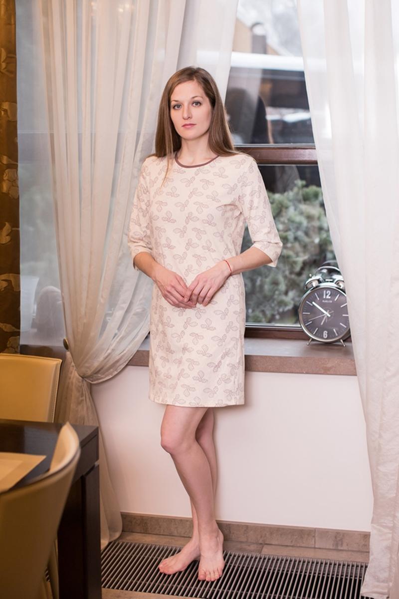 Платье домашнее Marusя, цвет: какао. 160072. Размер L (48)160072Домашнее платье Marusя Лепестки выполнено из эластичного хлопка. Модель средней длины с рукавами до локтя имеет круглый вырез горловины. Изделие оформлено мелким цветочным узором.