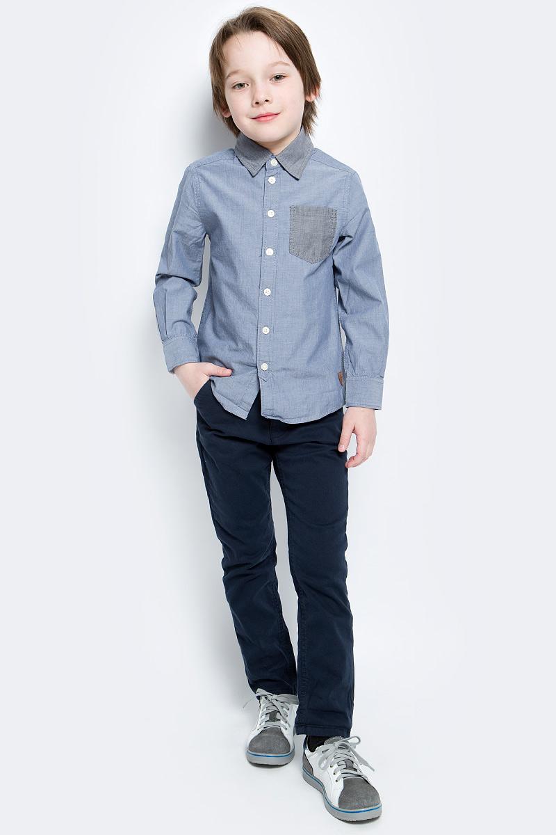 Рубашка2031704.40.82_1000Рубашка Tom Tailor для мальчика выполнена из высококачественного материала. Модель классического кроя с длинными рукавами и отложным воротником застегивается на пуговицы по всей длине. На манжетах предусмотрены застежки-пуговицы. Модель дополнена на груди накладным карманом.