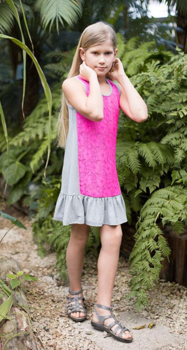 Платье718021Трикотажное платье свободного кроя декорировано контрастным кружевом и воланом по низу изделия.