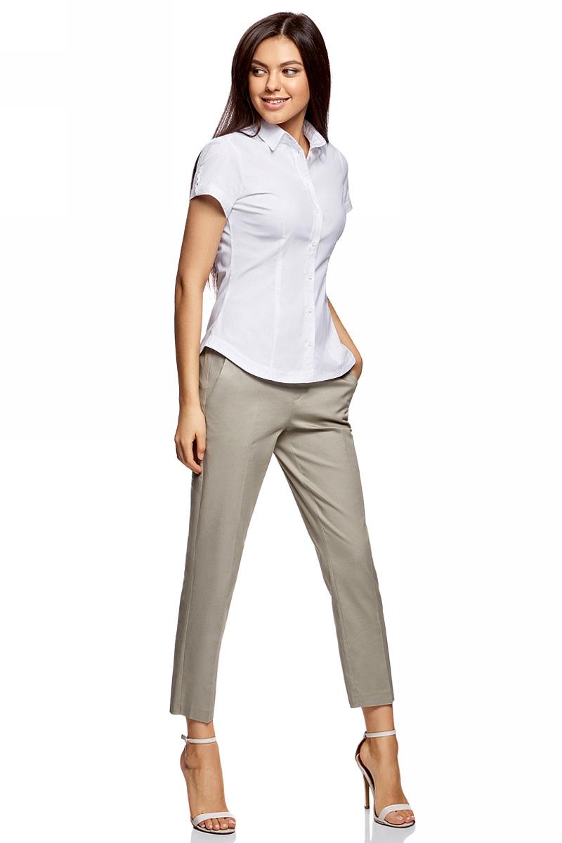 Рубашка женская oodji Ultra, цвет: белый. 11401238-2B/45151/1000N. Размер 38-170 (44-170)11401238-2B/45151/1000NРубашка женская oodji Ultra выполнена из высококачественного материала. Модель с отложным воротником и короткими рукавами застегивается на пуговицы.
