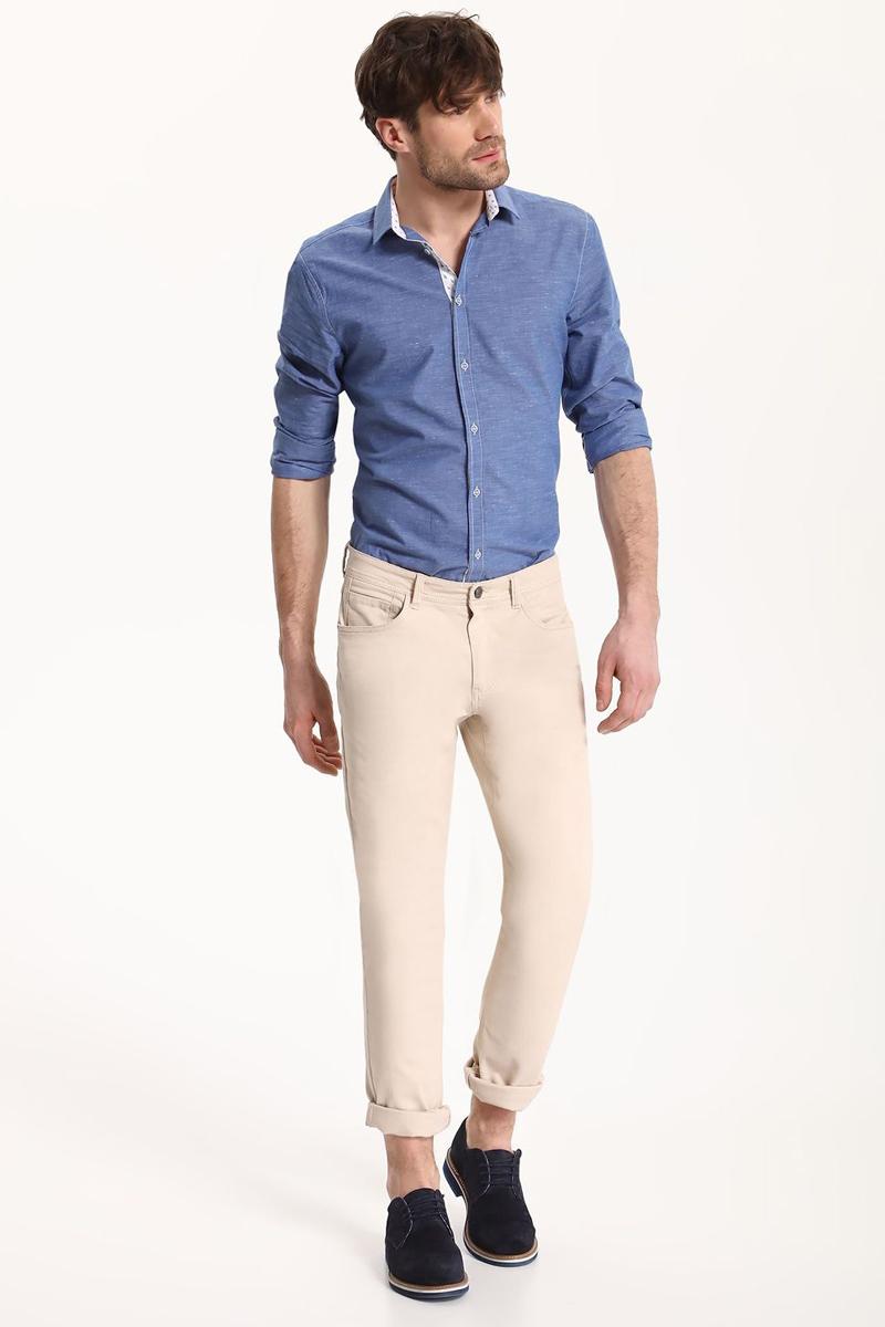 РубашкаSKL2324BLРубашка мужская Top Secret выполнена из хлопка и полиэстера. Модель с отложным воротником и длинными рукавами застегивается на пуговицы.