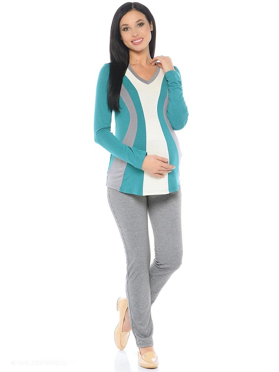 Блузка для беременных 40 недель, цвет: бирюзовый, серый, молочный. 200229. Размер 42200229Модная блузка для беременных от бренда 40 недель выполнена из вискозного полотна в комбинированной расцветке. Модель полуприталенного силуэта, с длинным рукавом и V-образным вырезом горловины. Передняя часть блузки выполнена из фигурных клиньев в гармоничной цветовой гамме. Такой крой визуально делает силуэт стройнее, создает объем для животика и позволяет комбинировать такую блузку со многими предметами гардероба на протяжении всего срока беременности и после него.
