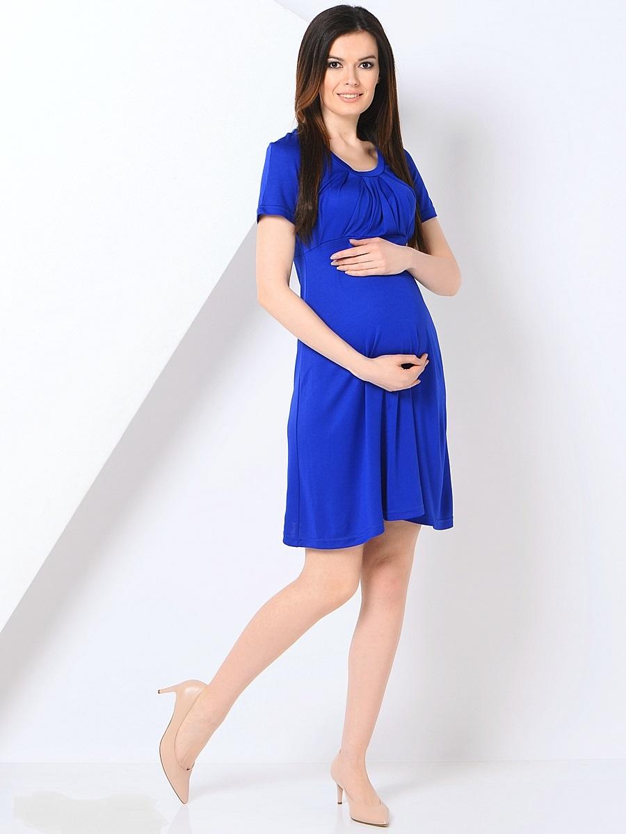 Платье для беременных 40 недель, цвет: синий. 301355. Размер 46301355Платье для беременных от бренда 40 недель - прекрасный вариант на каждый день. Изделие выполнено из хлопка с добавлением лайкры. Модель с коротким рукавом-реглан и круглым вырезом горловины. Оригинально задрапированный лиф и трапециевидный покрой создают элегантный образ уверенной в себе женщины. Благодаря уникальному крою это платье вы сможете носить на протяжении всего срока беременности и после него. Такое платье идеальный вариант для различных мероприятий и для работы в офисе.