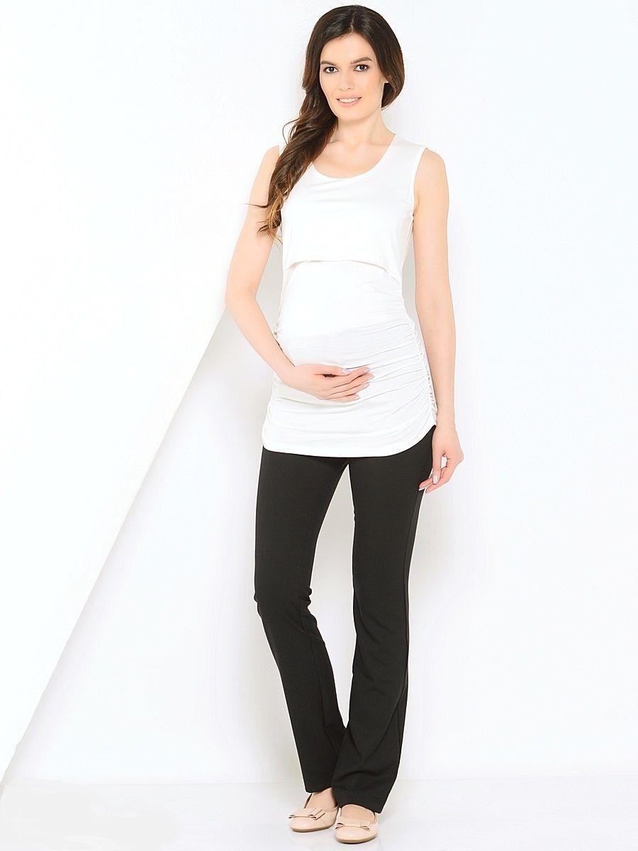 Брюки для беременных 40 недель, цвет: черный. 10107/9. Размер 4410107/9Модные брюки для беременных от бренда 40 недель, выполненные из мягкого трикотажного полотна, подарят комфорт будущей маме.Модель прямого покроя, дополнена шлевками для ремня и мягким поясом. Брюки отлично садятся по фигуре, не сковывают движений, обеспечивают комфорт на любом сроке беременности.Брюки прекрасно комбинируются со многими предметами гардероба классического офисного и повседневного стилей.