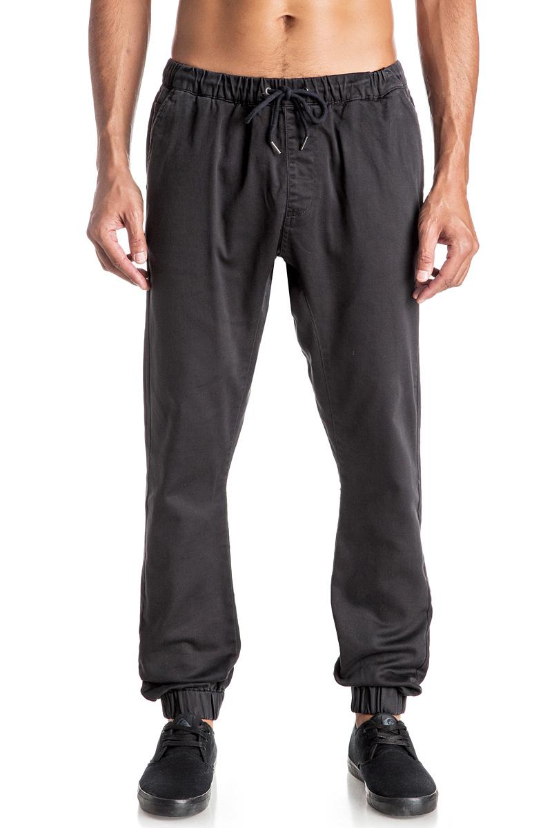 Брюки мужские Quiksilver, цвет: темно-серый. EQYNP03107-KTA0. Размер M (48)EQYNP03107-KTA0Стильные мужские брюки джоггеры Quiksilver со слегка заниженной ластовицей изготовлены из эластичного хлопка. Модель на талии имеет широкую эластичную резинку и дополнена затягивающимся шнурком и имитацией ширинки. Спереди брюки имеют два прорезных кармана и один небольшой накладной карман, сзади два прорезных кармана на застежках-пуговицах. Низ брючин дополнен резинками.