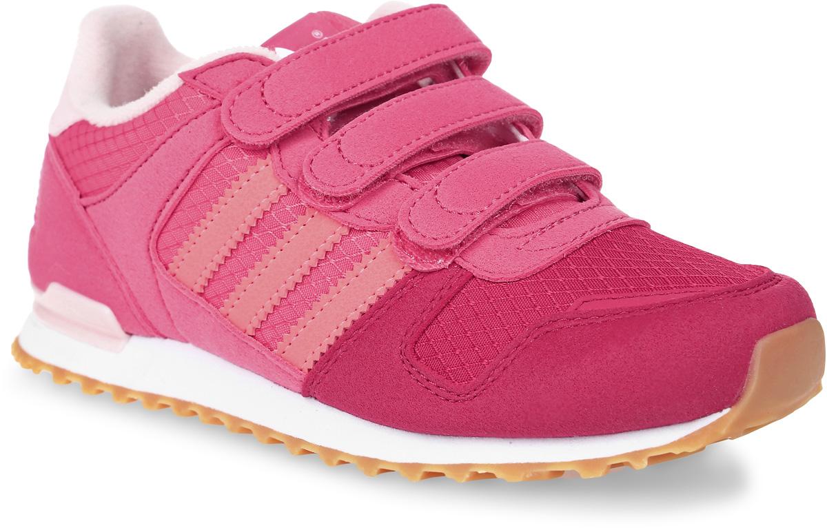 Кроссовки детские adidas Zx 700 Cf, цвет: розовый. S76246. Размер 35S76246Детские кроссовки adidas Originals Zx Flux C выполнены из сетчатого текстиля и дополнены вставками из искусственной кожи. Язычок украшен ярлыком в логотипом бренда. Обувь фиксируется на ноге при помощи классической шнуровки. Подкладка выполнена из текстиля. Термопластичная литая дышащая стелька OrthoLite® из ЭВА обеспечивает длительную амортизацию при небольшом весе, препятствует распространению бактерий, вызывающих запах, благодаря специальному составу с диметилоктадецил [3-(триметоксисилил)пропил] аммония хлоридом. Подошва из резины дополнена оригинальным рифлением, пяточный каркас выполнен из термополиуретана, как на аутентичных моделях ZX 80-х годов.