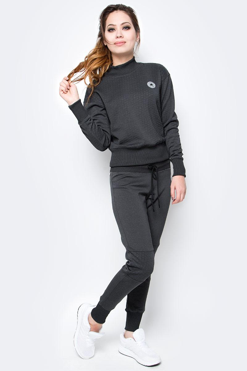 Брюки спортивные10003546001Женские спортивные брюки Converse изготовлены из качественного эластичного материала. Модель на широкой эластичной резинке и шнурке дополнена текстильными вставками на коленях. Низы брючин дополнены широкими резинками. Такие брюки незаменимая вещь в спортивном и летнем гардеробе. Прекрасный выбор для занятий фитнесом или активного отдыха.