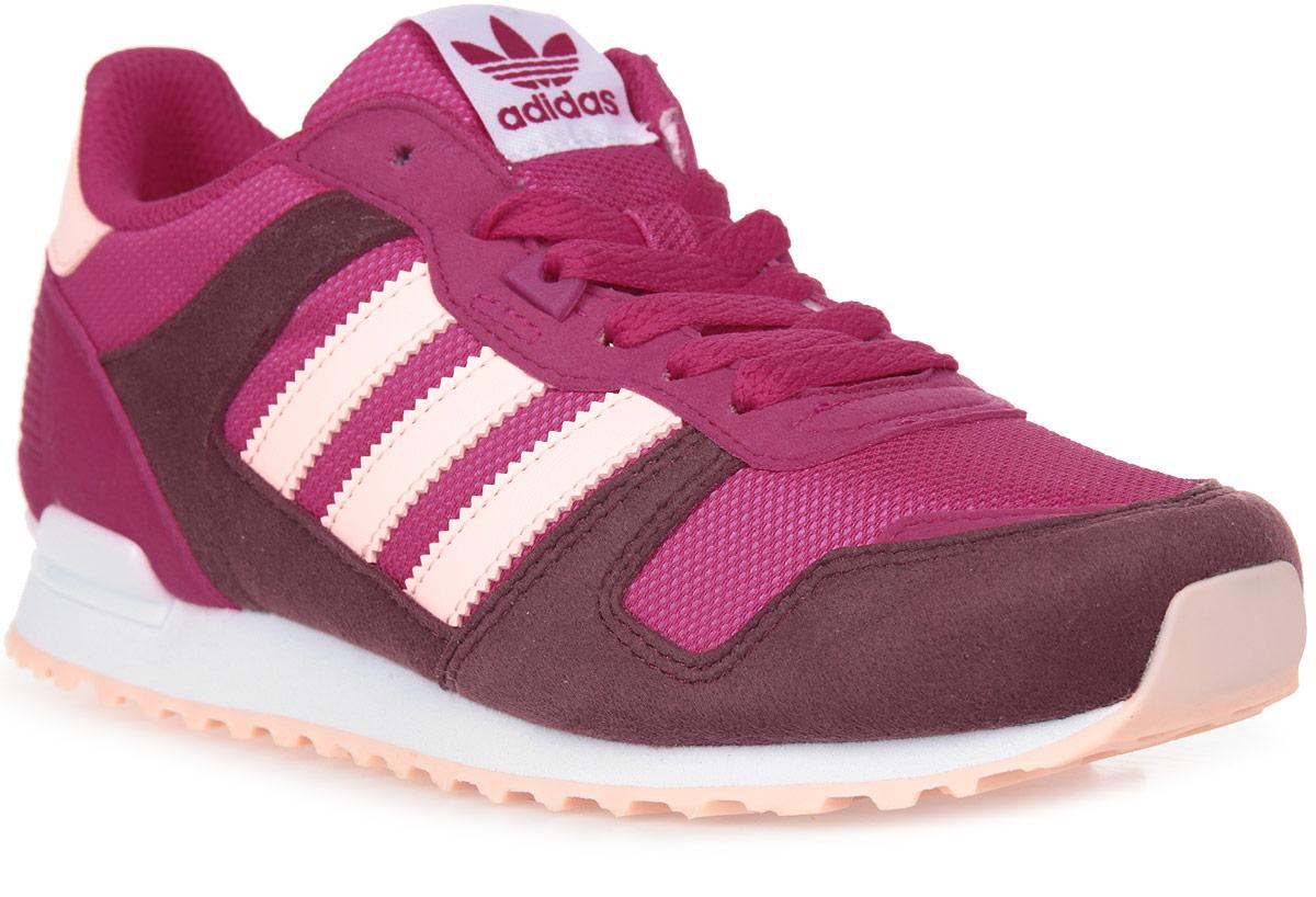 Кроссовки для девочки adidas ZX 700 J, цвет: красный, бордовый, белый. BB2445. Размер 6,5 (38,5)BB2445Популярный в 80-х силуэт, обновленный для современных улиц. Детские кроссовки с сетчатым верхом выполнены в винтажной цветовой гамме и дополнены вставками из мягкой замши. Задник из термополиуретана, как на оригинальных ZX. Комфортная и функциональная стелька OrthoLite® с антимикробным покрытием; литая промежуточная подошва из ЭВА для оптимальной амортизации.