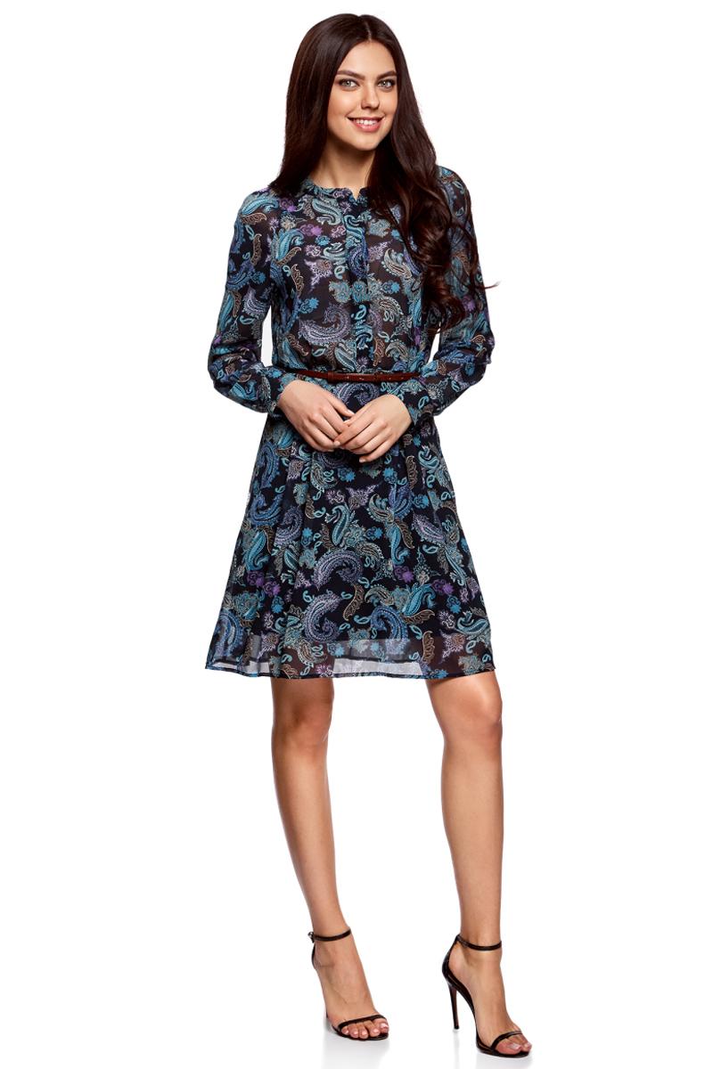 Платье oodji Collection, цвет: темно-синий, бирюзовый. 21912001-1M/38375/7973E. Размер 42-170 (48-170)21912001-1M/38375/7973EПлатье oodji Collection полуприлегающего кроя выполнено из шифона и оформлено ярким принтом. Модель средней длины с круглым вырезом горловины и длинными рукавами-реглан застегивается спереди и на манжетах на пуговицы; сбоку имеется скрытая застежка-молния. Платье подойдет для офиса, прогулок и дружеских встреч и станет отличным дополнением гардероба в летний период. Мягкая ткань на основе полиэстера приятна на ощупь и комфортна в носке.В комплект с платьемвходит узкий ремень из искусственной кожи с металлической пряжкой.