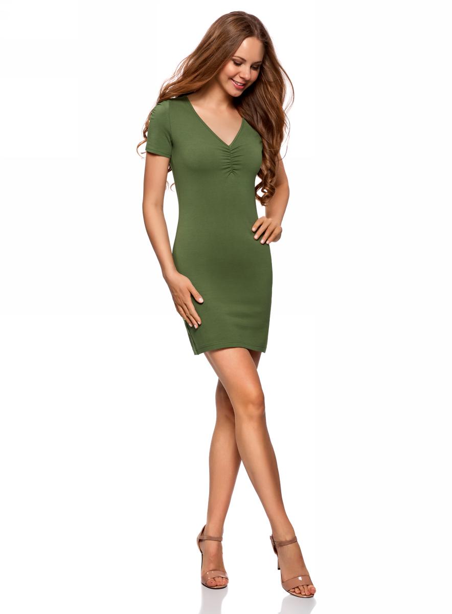 Платье oodji Ultra, цвет: темно-зеленый. 14001082B/47490/6900N. Размер S (44)14001082B/47490/6900NОблегающее платье oodji Ultra выполнено из качественного трикотажа. Модель мини-длины с V-образным вырезом горловиныи короткими рукавамивыгодно подчеркивает достоинства фигуры.