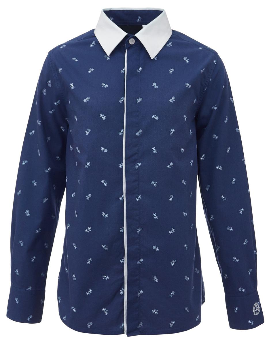 Рубашка для мальчика Gulliver, цвет: синий. 217GSBC2311. Размер 146217GSBC2311При всем богатстве выбора, купить рубашку для мальчика высокого качества не очень просто. Школьная рубашка должна отлично выглядеть, хорошо сидеть, соответствовать актуальной форме, быть всегда свежей, выглаженной и опрятной. Именно поэтому состав, плотность и текстура материала имеют большое значение! Рубашка с мелким рисунком - тренд сезона! Она не нарушает школьный дресс-код, но делает повседневный Look ярче и интереснее, создавая позитивное настроение. Контрастная отделка суппатной планки, белый воротник и деликатная фирменная вышивка на манжете придают модели выразительность и индивидуальность.