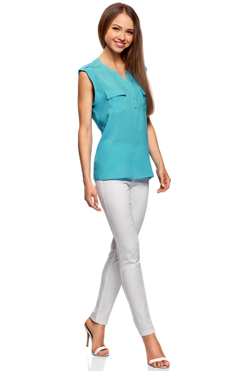 Блузка жен oodji Collection, цвет: бирюзовый. 21412132-2B/24681/7300N. Размер 40-170 (46-170)21412132-2B/24681/7300NБлузка из принтованной вискозы с двумя карманами