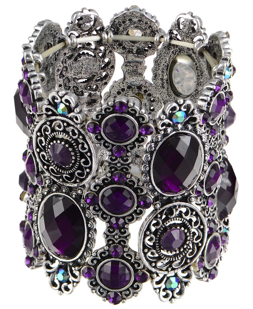 Браслет Taya, цвет: серебряный, фиолетовый. T-B-7409T-B-7409-BRAC-PURPLEСтильный браслет Taya выполнен из бижутерийного сплава. Элементы оригинальной формы оформлены вставками из сияющих стразов граненых камней. Благодаря эластичной основе и подвижным элементам изделие идеально разместиться на запястье. Такой браслет позволит вам с легкостью воплотить самую смелую фантазию и создать собственный, неповторимый образ.