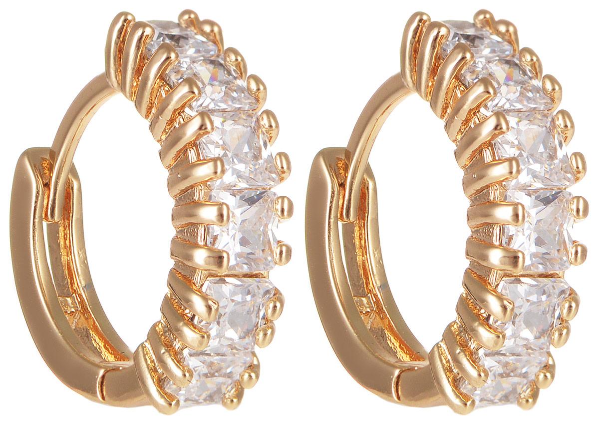 Серьги Taya, цвет: золотистый. T-B-11694T-B-11694-EARR-GOLDМодные позолоченные серьги Taya изготовлены из бижутерного сплава и оформлены цирконами. Застегивается изделие с помощью замка-конго. Оригинальные серьги внесут изюминку, как в повседневный, так и в выходной образ и позволят выделиться среди окружающих.