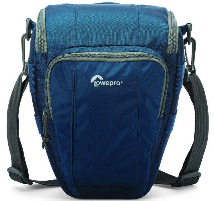 Lowepro Toploader Zoom 50 AW II, Blue сумка для фотокамерыLP36703-0RUВторое поколение сумок серии Toploader Zoom AW II предоставляют надежную защиту в течения дня на прогулке, в путешествие или при спортивной съемке. Компактные, оснащенные возможностью быстрого доступа к камере сумки, которые можно носить тремя способами (на плече, поясе или с помощью специальной разгрузочной системы Topload Chest Harness). Бегунки застежек-молний, которые легко открываются и закрываются при низких температурах, имеют специальные D-образные кольца: их просто нащупать, за них легко ухватиться. На светло-серой ткани отделки основного отсека сумок быстрее можно разглядеть нужную вещь. Все сумки серии оснащены встроенным всепогодным защитным чехлом All Weather AW Cover и вместительным фронтальным карманом на молнии для разных полезных мелочей, кошелька или документов