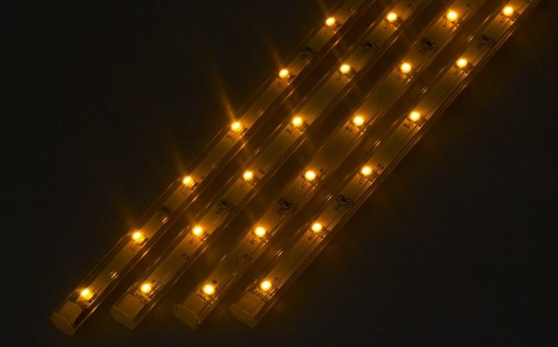 Светодиодный светильник линейный, 4 шт х 25см. Цвет желтый145-102Линейный светодиодный светильник - это светодиодная линейка длиной 25 см, заключенная в корпус из прозрачного пластика. Они могут использоваться в подсветке витрин, мебели, а так же в интерьерной подсветке. Простота монтажа поможет без проблем справиться с вопросом освещения необходимых зон. Блок питания понижающий напряжение до 12 В делает устройство безопасным в изпользовании. Использование светодиодных светильников является выгодным решением, так как они обладают высокой яркостью свечения, большим сроком службы и вместе с этем низким энергопотреблением. Цвет свечения - желтый. Поставляется по 4 шт. в комплекте с блоком питания.