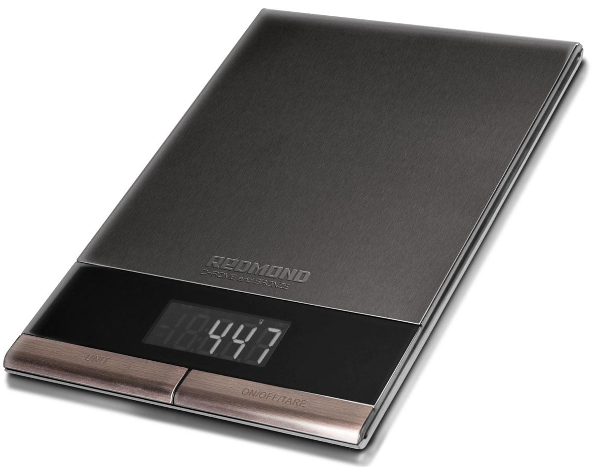 Redmond RS-CBM747 кухонные весыRS-CBM747Кухонные весы Redmond RS-CBM747 – новая мультифункциональная модель c платформой из нержавеющей стали в роскошном люксовом дизайне из эксклюзивной серии CHROME and BRONZE. Помимо широких возможностей это высокотехнологичное устройство отличает премиальное сочетание классического чёрного и естественного бронзового цветов. Этот элегантный кухонный аксессуар позволит рационально питаться, отслеживая вес ингредиентов и непременно подчеркнёт индивидуальный стиль помещения, гармонично вписавшись в дорогой интерьер. Кухонные весы RS-СВM747 способны взвесить продукт массой от 1 грамма до 5 килограммов с точностью до одного грамма. Для этого в приборе предусмотрены четыре очень чувствительных датчика. Радует и богатый набор функций: вычет веса тары, автоматическое отключение, выбор единицы измерения. Redmond RS-CBM747 имеют удобный и чёткий дисплей с подсветкой и устойчивые ножки. Вы сразу оцените всю пользу от этих кухонных весов, которые помогут вести...
