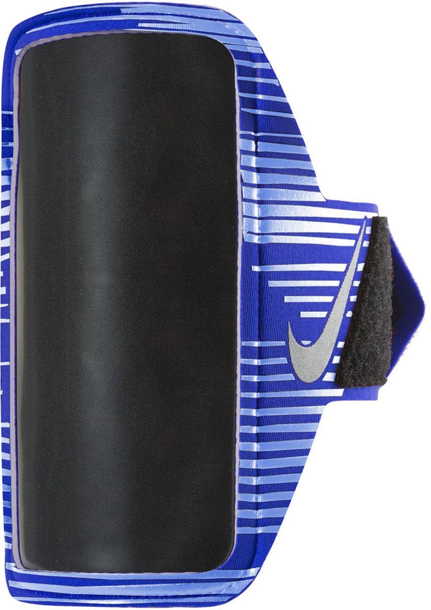 Чехол для телефона на руку Nike Printed Lean Arm Band, цвет: синий, черныйN.RN.68.439.OSСовместим практически со всеми смартфонами.Карман для устройства оснащен удобным входом.Удобная застежка на липучке обеспечивает прочную посадку на руке.Прозрачная защитная пленка не дает царапаться экрану устройства и сохраняет сенсорные свойства.Светоотражающий логотип улучшает видимость при слабом освещении
