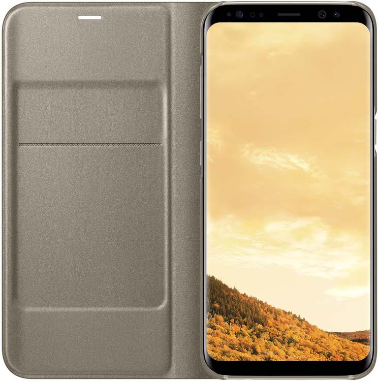 Samsung LED-View чехол для Galaxy S8, GoldEF-NG950PFEGRUЧехлы LED View Cover предназначены для флагмана от Samsung ? Galaxy S8. Верхняя крышка флип-кейса оснащена чувствительным сенсором, который реагирует на открытие/закрытие и нажатие кнопки питания. На передней панели чехла отображается текущая информация экрана – время, процент заряда, пропущенные вызовы и смс. Очередная фишка чехла – возможность отвечать на звонки, не открывая его, - просто проведите пальцем по панели, как по экрану. Чехол плотно прилегает к смартфону и предохраняет модель от падений и попадания пыли.
