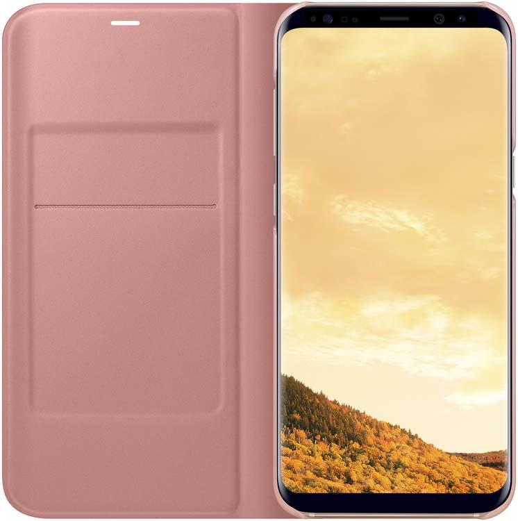 Samsung LED-View чехол для Galaxy S8+, PinkEF-NG955PPEGRUЧехлы LED View Cover предназначены для флагмана от Samsung ? Galaxy S8+. Верхняя крышка флип-кейса оснащена чувствительным сенсором, который реагирует на открытие/закрытие и нажатие кнопки питания. На передней панели чехла отображается текущая информация экрана – время, процент заряда, пропущенные вызовы и смс. Очередная фишка чехла – возможность отвечать на звонки, не открывая его, - просто проведите пальцем по панели, как по экрану. Чехол плотно прилегает к смартфону и предохраняет модель от падений и попадания пыли.