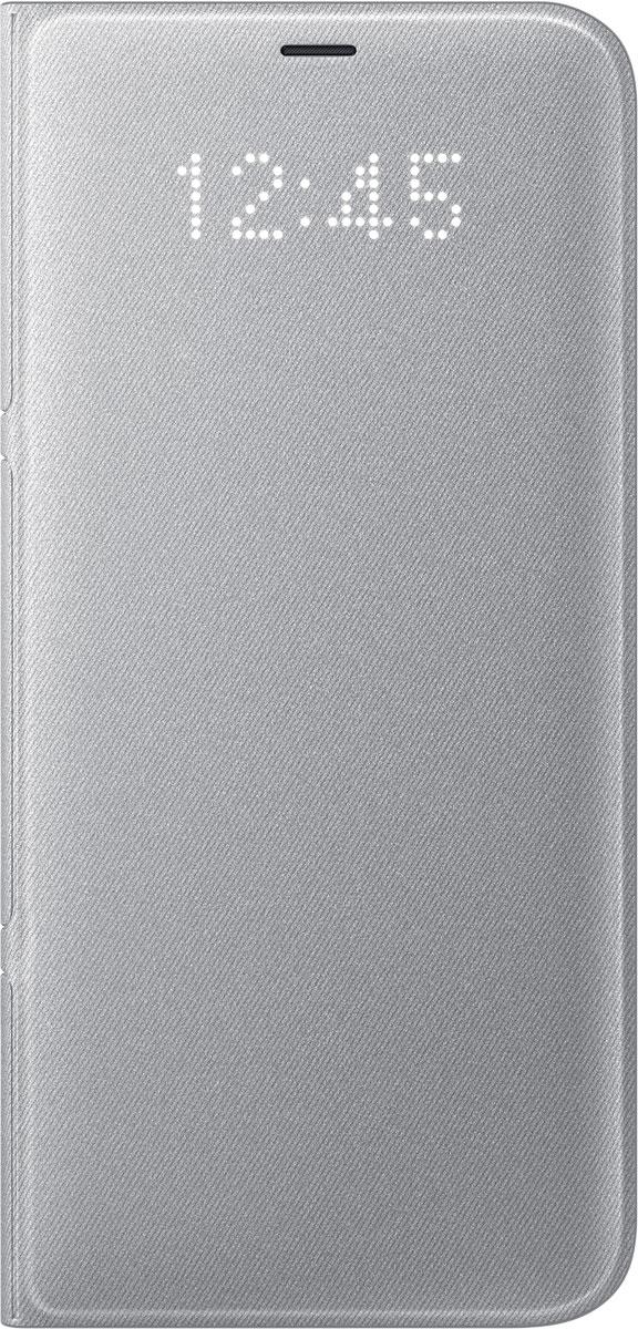Samsung EF-NG955 LED-View чехол для Galaxy S8+, SilverEF-NG955PSEGRUЧехол LED View Cover предназначен для флагмана от Samsung - Galaxy S8+. Верхняя крышка флип-кейса оснащена чувствительным сенсором, который реагирует на открытие/закрытие и нажатие кнопки питания. На передней панели чехла отображается текущая информация экрана - время, процент заряда, пропущенные вызовы и смс. Очередная фишка чехла - возможность отвечать на звонки, не открывая его, - просто проведите пальцем по панели, как по экрану. Чехол плотно прилегает к смартфону и предохраняет модель от падений и попадания пыли.