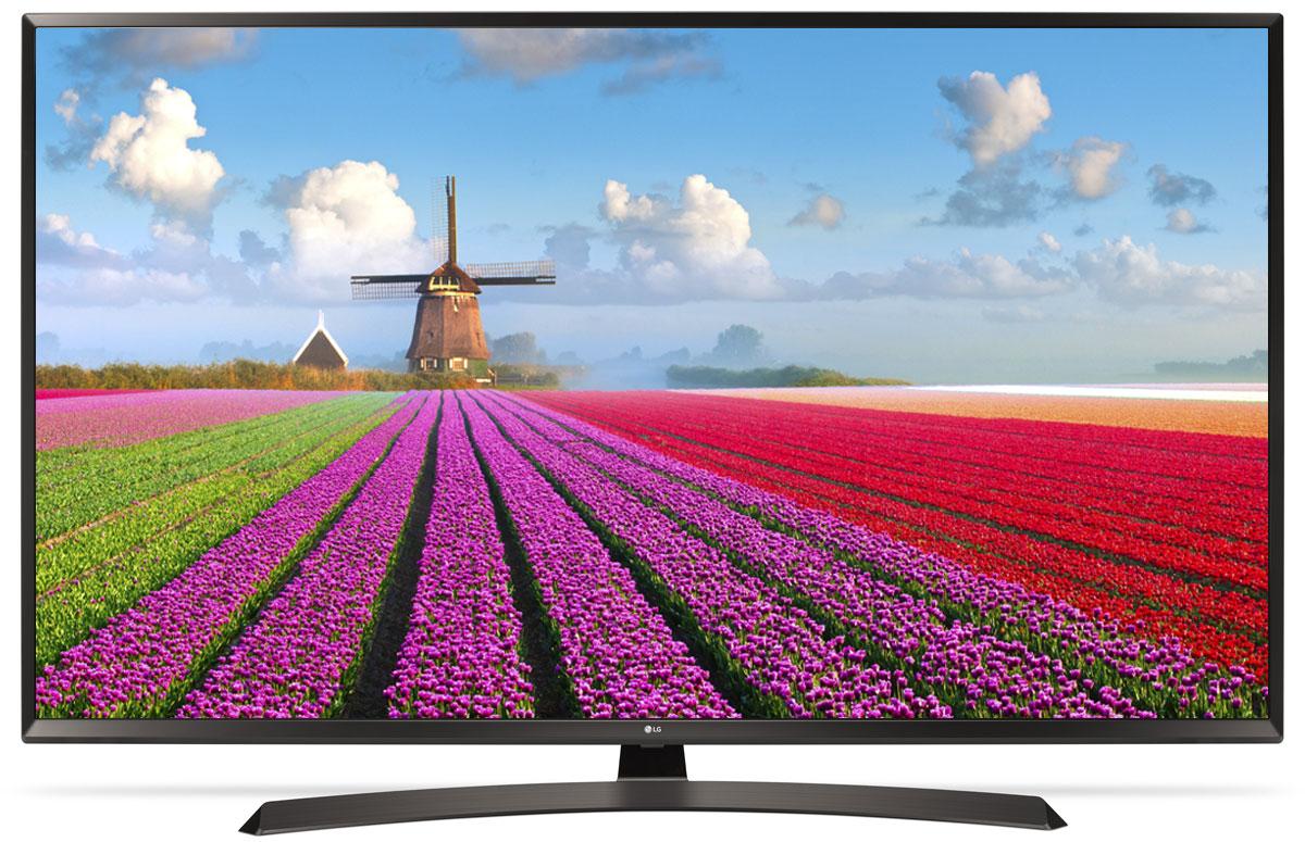 LG 49UJ634V телевизор90000004358Телевизор LG 49UJ634V передает точную цветопередачу и контрастность. С технологией IPS 4K цвета выглядят ярче и контрастнее под каким бы углом вы ни взглянули на экран.Технология Active HDR анализирует и оптимизирует контент в форматах HDR10 и HLG, создавая еще более захватывающее изображение с широким динамическим диапазоном. Благодаря особой технологии обработки видео в форматах HDR10 и HLG выбор HDR-контента становится шире.Уникальный режим HDR Effect увеличивает контрастность контента, снятого в стандартном динамическом диапазоне, и тем самым создает эффект HDR-качества.Используя алгоритм обработки видео 4K Upscaler, можно масштабировать изображение до разрешения 4К.Наполните пространство вокруг себя богатым звуком. Окунитесь в глубины звука благодаря новейшей технологии симуляции семиканального звучания.Современный пульт Magic Remote и обновлённый интерфейс webOS 3.5 создают максимальный комфорт для погружения в новый яркий мир: самое время окунуться в интригующий сюжет.