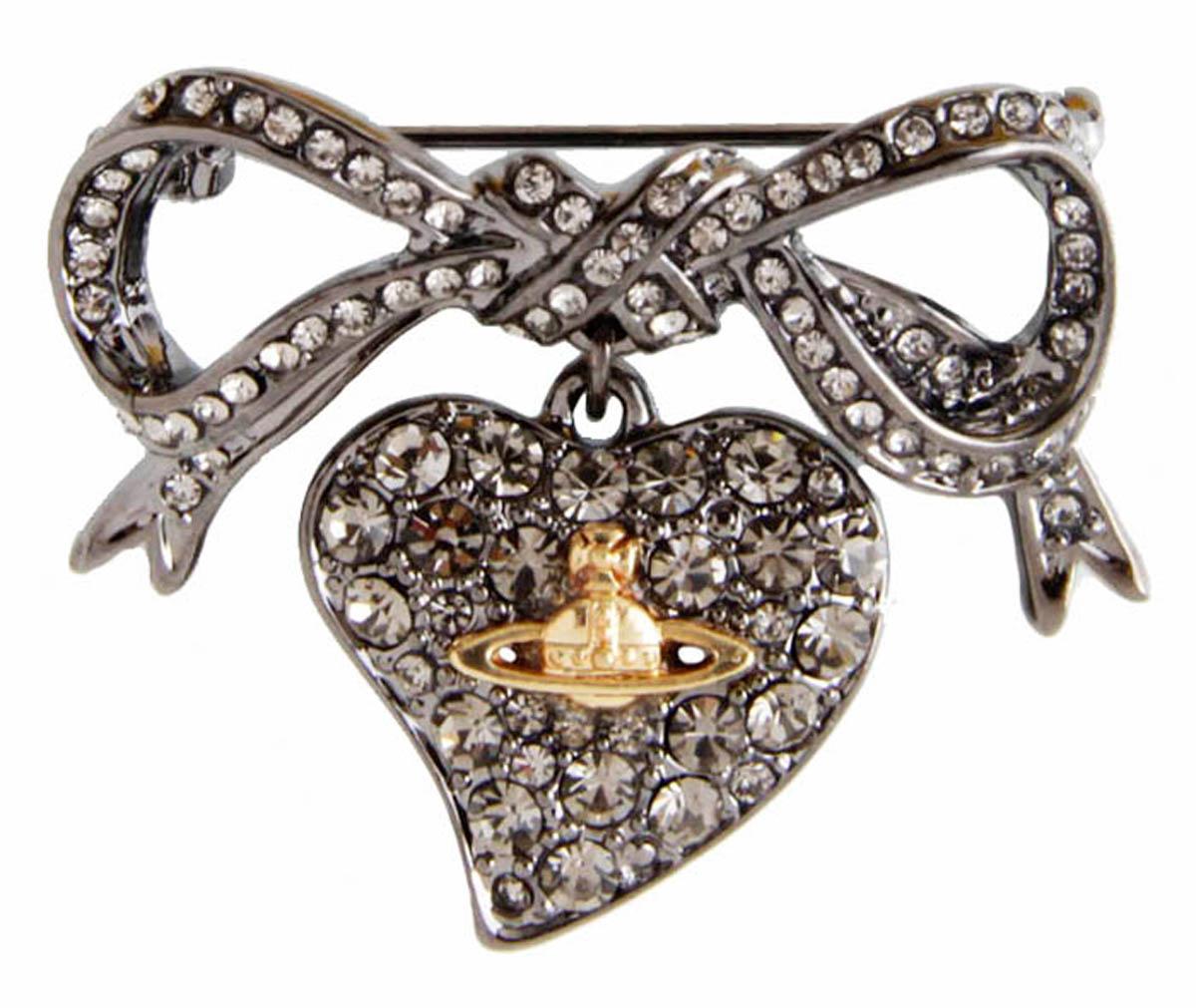 Брошь Сердце в стиле Vivienne Westwood. Бижутерный сплав, кристаллыБрошь-кулонБрошь Сердце в стиле Vivienne Westwood. Бижутерный сплав, кристаллы. Размер 3,5 х 3,5 см. Сохранность хорошая. Предмет не был в использовании.Филигранная брошь выполнена из бижутерного сплава серебряного тона.Очаровательная, притягивающая взгляды брошь.Снабжена удобной и надежной застежкой.Брошь - отличное дополнение вашего наряда.