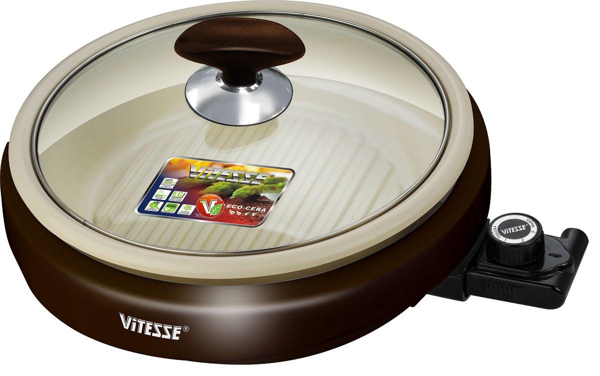 Vitesse VS-447 универсальная электросковородаVS-447Vitesse VS-447 позволяет готовить сотни блюд в различных вариациях, удивляя даже опытных поваров! А главное – электросковороду Vitesse можно размещать абсолютно в любом удобном для Вас месте, ведь она работает от сети и ее не нужно ставить на плиту. Такая вещь, несомненно, будет кстати на даче или в загородном доме!Внутреннее керамическое покрытие ECO-CERA, отличающееся гигиеничностью, прочностью и хорошими антипригарными свойствами способствует равномерному распределению тепла и дает отличную возможность готовить с минимальным количеством масла. Нежное мясо, рыба или птица, приготовленные на сковороде Vitesse, получатся вкусными и натуральными! Кроме того, антипригарное покрытие ECO-CERA очень легко содержать в чистоте: после приготовления его достаточно сполоснуть теплой водой с небольшим количеством моющего средства. Ребристая поверхность сковороды, равномерно распределяющая тепло и имитирующая решетку гриля на открытом огне, помогает добиться золотистой хрустящей корочки, сохранив аппетитную сочность продукта внутри.Хотите потушить или сварить продукты? Выберите для этого оптимальную температуру – 100 градусов! Немного повысьте ее и приготовьте изумительные запеченные или жареные блюда! Желаете порадовать домашних и гостей блюдами на гриле? Используйте самый высокий температурный режим 210 градусов, предусмотренный в VS-447. А если Вам необходимо разогреть готовое блюдо, воспользуйтесь режимом 40-80 градусов!Электросковорода Vitesse имеет терморегулятор для подбора определенной температуры! Терморегулятор легко снимается, при этом все неэлектрические части прибора можно мыть в посудомоечной машине. Прозрачная крышка сковороды из термостойкого стекла обеспечивает комфорт в использовании и позволяет следить за процессом приготовления. Внешний корпус VS-447 из прочного пластика делает эксплуатацию сковороды абсолютно безопасным, не позволяя хозяйке обжечься. Компактная и функциональная электросковорода Vitesse – эт